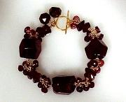 Bracelet: Garnets with 18K gold