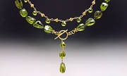 Two necklaces: Peridot, 18K gold
